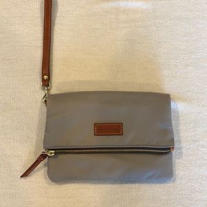 NEVER BEEN USED! Dooney & Bourke pewter wristlet.